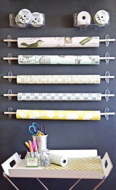 Any nook can become a gift-wrapping station.  Save your walls from screw and nail holes and use Command Brand clear hooks to hold up wooden dowels. (cmp.ly/3 )