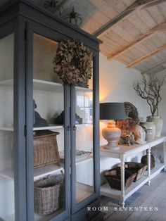 Gray - grey painted cabinet with white interior at Room Seventeen