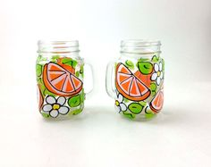 Hand Painted Orange Slices and White Flowers on a Glass Mason Jar  This Listing is for 2 Glass Mason Jars  Each of our hand painted items are painted in our Portland Oregon studio and then fired at a low temperature to adhere the paint to surface of glassware, drink-ware, wine glass for a long lasting durable finish, which can technically go in the dishwasher, top shelf...  However, I do recommend washing by hand with dish soap and soft sponge