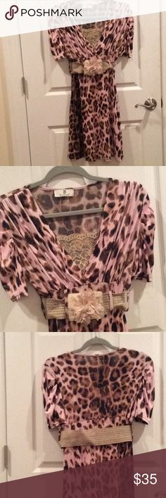 Animal print dress Classy and slinky. Light pink, brown and black animal print. Elastic belt which buttons closed. Has been worn once. Bought in a boutique.  It's a beauty. Casting Dresses Midi