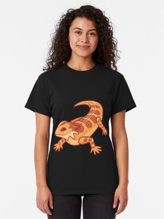 This cute little orange bearded dragon is right at home on apparel,  decor or accessories. If you or someone you know loves lizards, this it  the design for you. #findyourthing #beardeddragon #dragon #tshirt