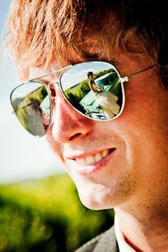 bride in grooms sunglasses refection