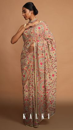 Beautified in the traditional art of Kashida embroidery and paisley & floral motifs, this beige hued georgette saree oozes charm and regality. This beauty is perfect to complement and enhance the poise and uniqueness of the wearer. . Kashida Embroidery, Indian Embroidery, Indian Fashion Dresses, Teen Fashion Outfits, Fashion Heels, Women's Fashion, Fitted Suit, Georgette Sarees, Saree Styles