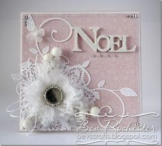 """bev-rochester-noel-handmade-muslin-flower: """"adhered scraps of the muslin (that I frayed a bit) [cheesecloth?] onto a 1"""" punched circle of card, I did this 3 times, using smaller scraps on each layer then finished off with a glizty bling spacer and button."""""""