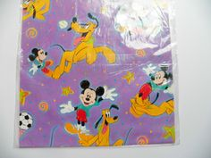 Vintage Hallmark Gift Wrap, Disneys Mickey Mouse Pluto Wrapping Paper  Disneys Mickey Mouse Pluto Gift Wrapping paper, New old stock by Hallmark, Made in USA, Factory Sealed pack of two sheets 30X20 each, Brightly colored, Factory folded, Features Soccer and Baseball theme, Great for childs birthday gift or for scrapbook paper..  for more vintage paper https://www.etsy.com/shop/YellowMod?section_id=16847877