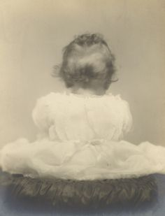 The back of Queen Elizabeth II's head. 1927.  Her mother, then the Duchess of York, made to travel for an extended period of time following the birth of her eldest daughter, requested photographs be taken of her from every angle so she could see her development whilst she was away.