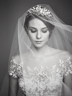 Combine a gilded head piece with a classic wedding veil for a custom combination that will have you feeling like royalty.