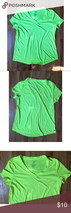 Electric Neon Yellow Active T-Shirt V style neckline. Short Sleeve t-shirt. Active brand Danskin, intended for high intense, moisture wicking sports. Color to reflect sun and not absorb heat. Size XL. 100% polyester. Some pilling present (discounted to reflect). Machine washable! Armpit to armpit measures 19.5in across. Length from armpit down 18in. Plenty of give and stretch in this shirt. If you have questions -- ask! Danskin Tops Tees - Short Sleeve