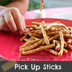 Using pretzels as edible Pick Up Sticks for family game night! #ideas #games #kids