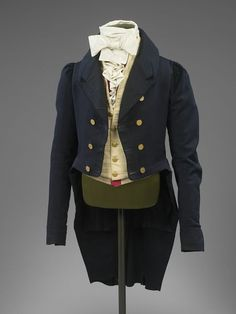 1830's-1830's Men's tailcoat. Notice the under-vest, clearly visible underneath the waistcoat - you can tell that only a small section of the vest is constructed from a fashion fabric, the rest is muslin.