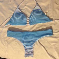 Reversible Brazilian bikini New, never worn in perfect condition. Cheeky Brazilian cut and cute pattern. Reversible with the light blue print and white Swim Bikinis