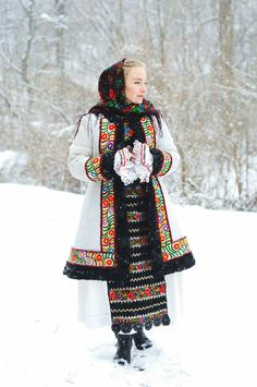 Sheepskin coat with floral embroidery. Modern day design by my grandfather based on antique traditional fashion from Năsăud.