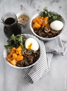 Barley and brown rice bowl. It's topped with all sorts of flavors and textures: roasted butternut squash, mushrooms, crispy kale chips, toasted sesame seeds, and a ridiculously delicious soft boiled egg. Remember that teriyaki sauce I made last week? That same sauce is used to bring this rice bowl together.