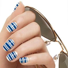 sea-ing stripes by essie - get on board with this maritime nail look to really sail into style.