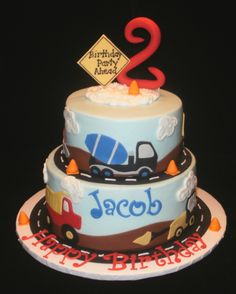 """Construction Birthday - This is a 6"""" chocolate and an 8"""" chocolate mint cake,,,iced in buttercream.  The road, vehicles, #2, signs and cones are all done in fondant.  Super fun to make!"""