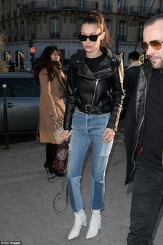 Bella Hadid shows catches the eye in edgy biker jacket Strutting: The beauty's funky blue jeans complemented her white ankle boots, which boosted her already statuesque height Bella Hadid Outfits, Bella Hadid Style, Booties Outfit, Estilo Gigi Hadid, Jeans Bleu, Blue Jeans, Trendy Outfits, Cute Outfits, White Ankle Boots