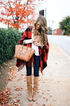 817. Lighter boots, skinnies, white long-sleeved tee, black and red plaid shawl/poncho