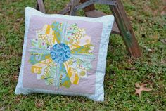 Have a leftover quilt block? Turn it into a pretty quilted throw pillow, featuring an envelope-style back and deep pockets, in this step-by-step tutorial!
