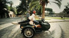 Discover Barcelona on a classic sidecar motorcycle by BrightSide Barcelona. Discover Barcelona seating in the sidecar of a classic motorcycle.