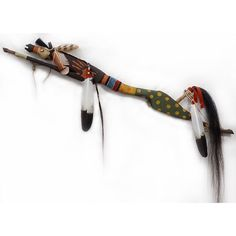 This horse dance stick features the carved figure of a spotted bear riding on it's back - it looks for danger and its powerful spirit protects the horse.