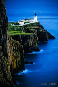 Neist Point lighthouse on the Isle of Skye, Scotland.  Love lighthouses anywhere - this one is spectacular.  I want to find out more about it.