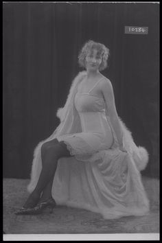 Glass Half Plate  Image of a woman modelling a corset. Published in Ladies Home Magazine.    Maker:  Bassano Studio  Production Date:  1923-04-04