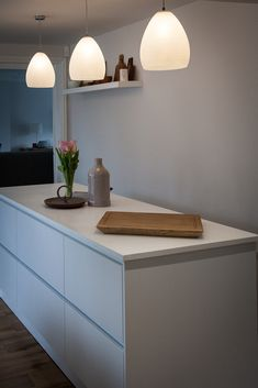 From our Schuller range, this handleless island has a Minerva in White worktop and cabinets in Crystal White. Kitchen Furniture, Floating Nightstand, Bespoke, Kitchen Ideas, Cabinets, Range, Crystal, Island, Home Decor
