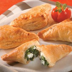 spinach and feta mini-calzones Recipe from    Feta cheese and spinach are wrapped in flaky puff pastry in this tasty appetizer. Good thing they're easy to make, because they're sure to disappear fast.