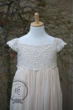 Beige Tan Crochet Lace Flower Girl Dress Boho Lace DressThis dress has beautiful crochet detail on top. The skirt of the dress has multiple layers of Tulle. The dress is lined with satin material. Back of the dress has satin ties. SHIPPING OPTIONS Updated on 4 March 2018 New Processing time. Processing time for this dr