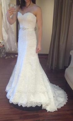 Brand new gorgeous wedding dress -- Swarovksi crystals, fit and flare, size 6 -- unaltered with tags and receipt