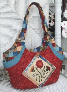 This fun Quattro bag was created with fabric from pat Slaon collection!