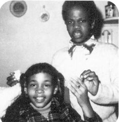 Whitney Houston and brother Gary. I love his expression.