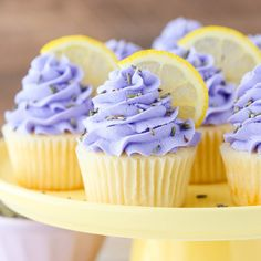 Lemon Lavender Cupcakes - easy lemon cupcakes with lavender buttercream frosting, topped with lavender flowers and fresh lemon slices.