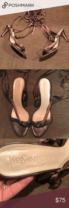 Yves Saint Laurent heels with satin ribbon ties Yves Saint Laurent heels in olive green with ribbon ties in very good condition with some where on soles. Heels are 4 1/2 inches Yves Saint Laurent Shoes Heels