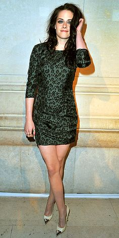 KRISTEN STEWART  At the same event, the star strikes a pose in her sexy Louis Vuitton ensemble of a fitted leopard mini, cap-toe pumps and mussed hair.