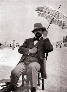 """composersdoingnormalshit: """"Claude Debussy holding an umbrella on a beach. Suite Bergamasque, Blues Music, Pop Music, Claude Debussy, Classical Music Composers, 19 Kids And Counting, Reggae Music, Daddy Yankee, Celebrity Couples"""