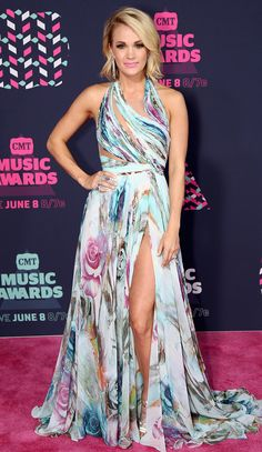 CARRIE UNDERWOOD // Country goes glam! From plunging necklines to crop tops, stars prove fashion is always bigger on the CMTs red carpet