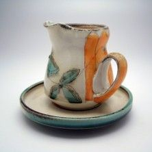 gravy boat w/ its own saucer; fun idea with handle on the side.  (Charity Davis-Woodard)