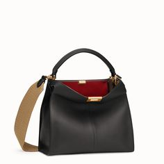 Medium handbag with internal pocket and iconic twist lock. Single handle and detachable shoulder strap. Made of black calf leather. Red leather lining. Black Leather Bags, Calf Leather, Fendi Peekaboo Bag, Lv Handbags, New Bag, Luxury Bags, Bag Making, Calves, Accessories