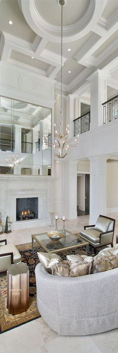 Beautiful two-story grand room with fabulous ceiling detailing.
