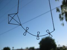 Let's Go Fly a Kite necklace by Against The Grain at the Brush Bar Boutique or on Etsy! $46.00