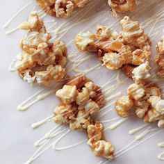 Caramel corn, a perennial Halloween favorite, gets an upgrade with the addition of chopped cashews and drizzled white chocolate. Serve alongside Caramel Apples.