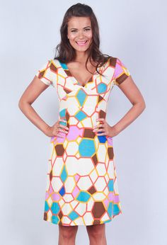 Was $79, Now $39.Stretch cotton lycra A-line dress with v-neck front and back and capped sleeve