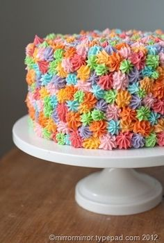 I LOVE this cake and especially the frosting techniques!  Definitely going to tackle this one!