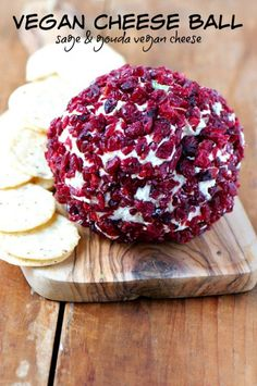 Festive Vegan Cheese Ball flavored with crispy sage, vegan gouda cheese, and covered with chopped craisins to add the perfect hint of sweetness. It's our favorite cheese ball ever!