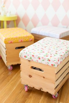 Rolling toy bins with upholstered seats | fabric from This Little Street