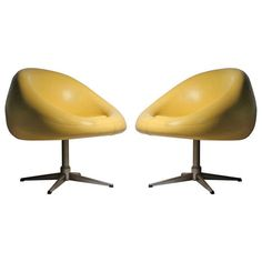 Pair of Overman Yellow 1970's POD Chairs | From a unique collection of antique and modern swivel chairs at http://www.1stdibs.com/furniture/seating/swivel-chairs/