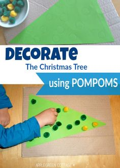 A Christmas-themed fine motor activity for toddlers. All you need are several pompoms and a piece of paper.