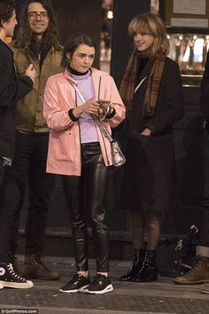 Sports chic: Maisie was typically trendy for the evening - slipping into a pair of bold le...