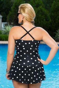 Cute as a button - this twin print polka dot plus size swimsuit features a shape flattering silhouette in a contemporary take on classic retro style.
